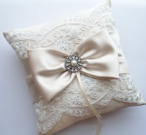 wedding photo - Wedding Ring Pillow in Champagne Satin with Beaded Ivory Alencon Lace, Satin Bow with Rhinestone and Pearl Center - The MELINDA Pillow