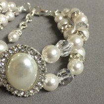 wedding photo - Swarovski Bridal Bracelet.  White Swarovski Pearls with Crystal and Pearl Oval Accent