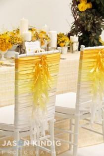 wedding photo - Take Several Seats With These Stylish Wedding Chair Covers