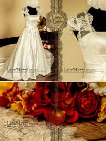 wedding photo - Vintage Inspired Lace Wedding Dress Features Cap Sleeves Full Lace Covered Back and Ribbon on the Waistline