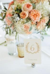 wedding photo - Elegant Peach And Cream Centerpieces