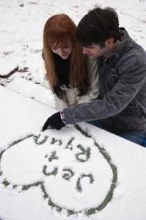 wedding photo - Snowy Engagement Photos - The SnapKnot Blog
