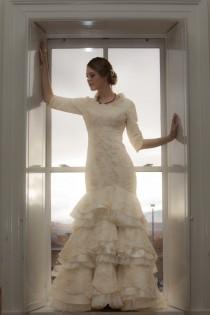 wedding photo - Ivory Wedding Dress with an asymmetrical sweetheart neckline, half sleeves and fit-and-flare multilayered skirting. Made to order