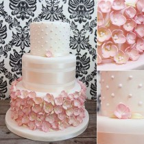 wedding photo - Wedding Cakes - Melissa L'Abbe Cakes - Pink Wedding Cake Covered With Pink Sugar Flowers And Satin Ribbon.