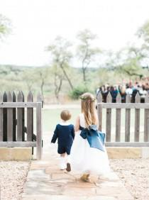 wedding photo - A Blanket Of Bluebonnets Made For The Ultimate Hill Country Wedding