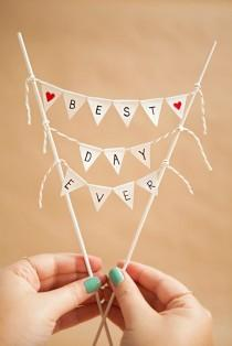 wedding photo - Learn How To Make A Darling And Simple Bunting Cake Topper!
