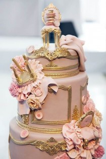 wedding photo - Fondant Louis XIV Chairs Tumbled Down This Ornately Gilded Wedding Cake By Cake Opera Co.