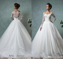 wedding photo -  Amelia Sposa 2016 Lace Wedding Dresses Long Sleeve Bridal Ball Gown Sexy Vintage Cheap V-Neck Arabic Sheer Wedding Dress Appliques Wedding Dresses Lace Wedding Dresses 2016 Wedding Dresses Online with 155.43/Piece on Hjklp88's Store
