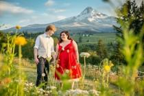 wedding photo - A spectacular literary wedding with a mountain backdrop and a killer red dress
