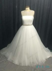 wedding photo - Plus size tulle ball gown wedding dress with beading details