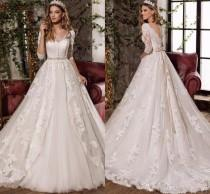 wedding photo -  Vestidos De Noviano 2017 Gorgeous A Line Wedding Dresses Beaded Sash Long Sleeves Tulle Appliques Lace Wedding Dress Bridal Gown Court Train Lace Luxury Illusion On