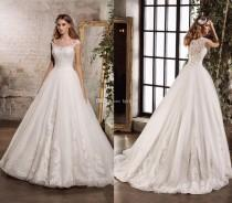 wedding photo -  2017 New Bateau Sheer Neck Lace Wedding Dresses Applique Beads Tulle Bridal Gowns A-Line Garden Wedding Dress Zipper Lace Luxury Illusion Online with $165.72/Piece