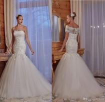wedding photo -  2017 New Arrival Mermaid Sexy Lace Wedding Dresses Tulle Lace Appliques Bridal Gowns Garden Wedding Dress Off-shoulder Detachable Bodice Lace Luxury Illusion Online