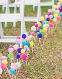 wedding photo - Use colorful yarn pom-poms as aisle decor