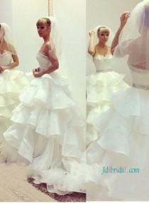 wedding photo - Gorgeous strapless tiered organza ball gown wedding dress