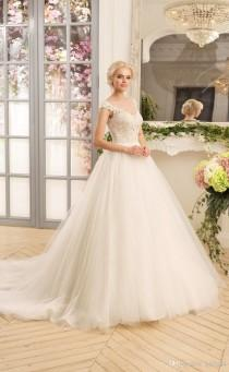 wedding photo -  2017 New V-Neck Vintage Lace Wedding Dresses Applique Tulle Bridal Gowns Backless A-Line Garden Wedding Dress NAVIBLUE BRIDAL Zipper Button Lace Luxury Illusion Onl