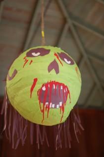wedding photo - Steal this zombie piñata idea for your reception