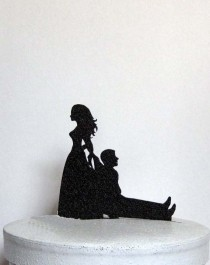 wedding photo - Funny and Unique Wedding Cake Topper - Bride Dragging Groom!