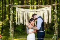 wedding photo - A macrame wedding backdrop is the BEST way to reuse decor