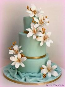 wedding photo - Wedding Cake With Sugar Lilies And Gold Details.