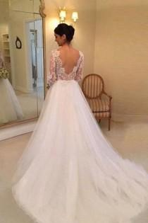wedding photo - A-line Long Sleeves Beading Lace Court Train Wedding Dress TN0048