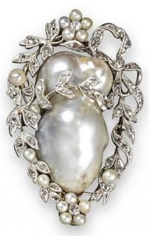 wedding photo - An Early 20th Century Pearl And Diamond Brooch. The Baroque Pearl Set Within A S