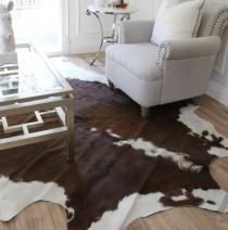 wedding photo - Chocolate brown and white cowhide rug