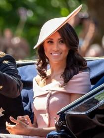 wedding photo - Meghan Shakes Up Her Royal Image By Ditching Her Sleeves