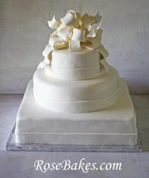 wedding photo - Elegant White Wedding Cake With Poofy Gum Paste Bow