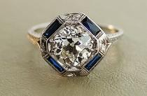 wedding photo - 1920s-antique-engagement-ring-with-center-diamond-and-sapphire-accents.full