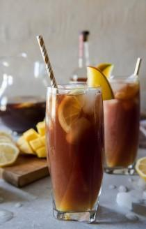 wedding photo - Change Up Your Brunch Beverage Game With This Southern Spiked Mango Iced Tea! Arnold Palmer-style Lemon Iced Tea Combined With Homemade Mango Necta…