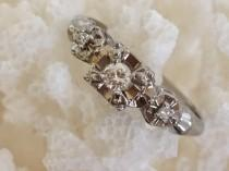 wedding photo - Antique Vintage Art Deco star flower 14K White Gold Diamond Engagement Ring with 2 Accent Diamonds. circa 1930's.