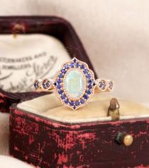 wedding photo - Oval Cut Opal Engagement Ring