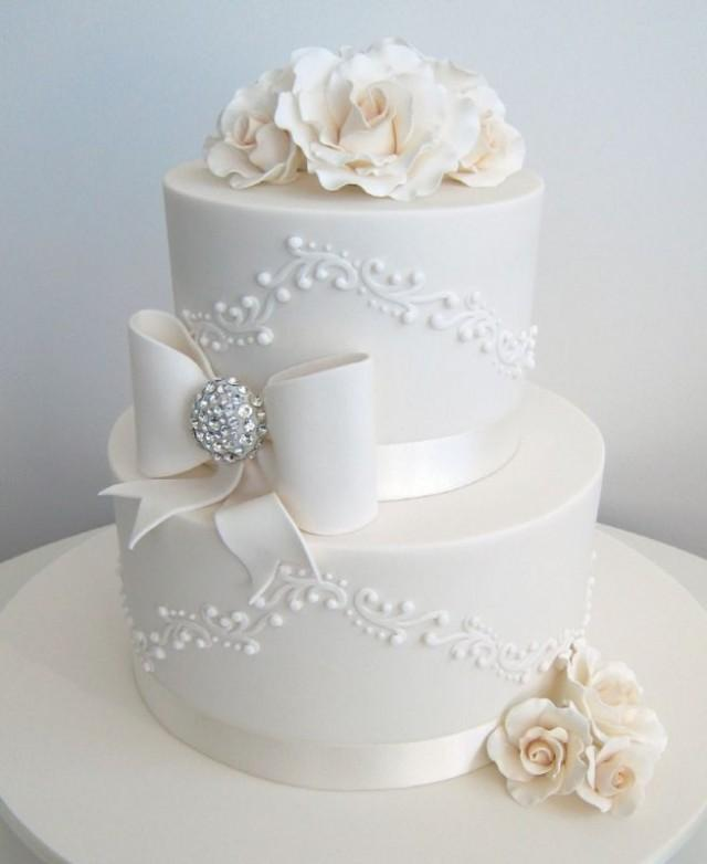 wedding cake with bows and bling cake bows with some bling 2044972 weddbook 26837