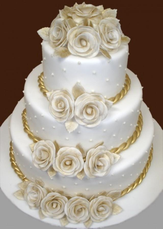 https://s3.weddbook.com/t1/2/0/6/2069648/white-and-gold-wedding-cake-glittering-gold-pinterest.jpg