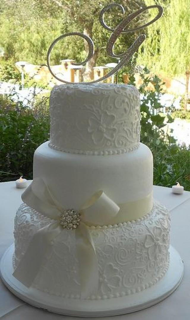 elegant all white wedding cakes cake weddings cakes 2232022 weddbook 13954