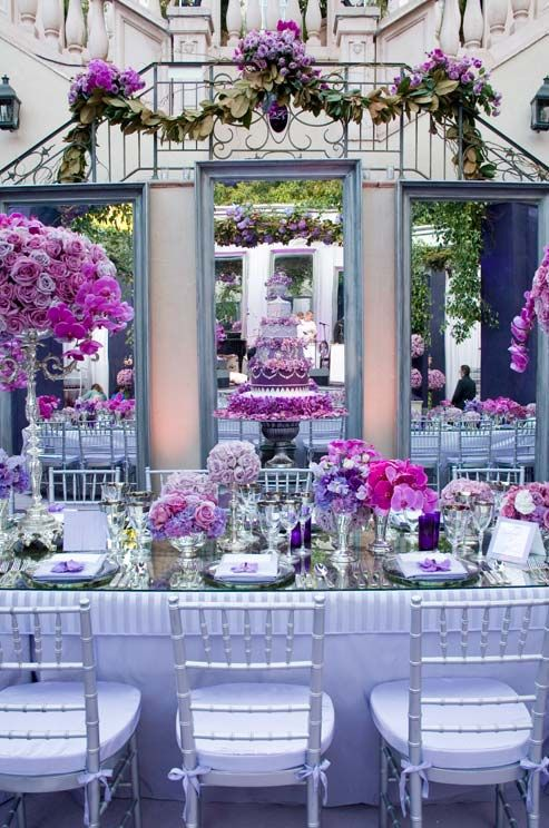 Three Large Mirrors Back The Head Table Showing Off Purple Cake And Dramatic Fl Arrangements