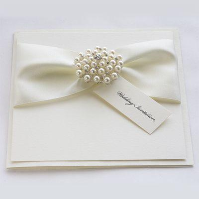 Satin Pearl Wedding Invitations With Luxury Ribbons And A Crystal Cer Embellishment
